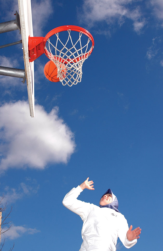 Muslim woman playing basketball