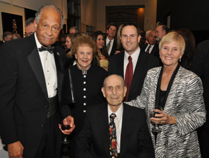 President Milton A. Gordon and his wife, Margaret, flank campus donors.