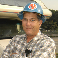 John Foster wearing a hard hat.