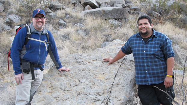 Adam Woods and student Pedro M. Monarrez stand in the foothils of Arrow Canyon, Nevada.