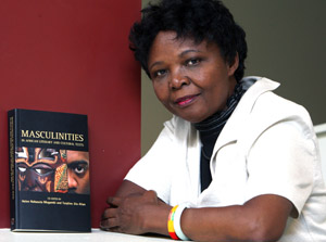 "Helen Mugambi with her book ""Masculinities in African Literature and Cultural Texts."""