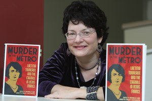 "Gayle Brunelle with two copies of her book ""Murder in the Metro"""