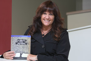 Kristi Kanel with her recently published book.