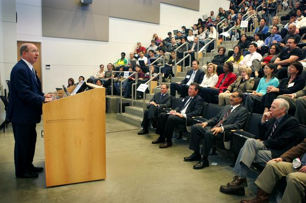 Lloyds chairman Peter Levene speaks before an audience in Mihaylo Hall's large tiered lecture hall