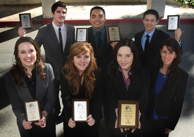 The six winners of a recent competition surround their adviser Pamela Fiber-Ostrow.