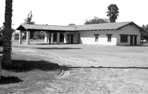A black and white photo of the service station built at Forty Acres.