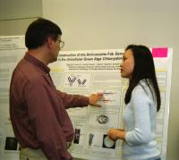 Professor and student discuss science poster
