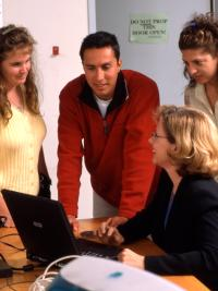 Faculty member consults with students