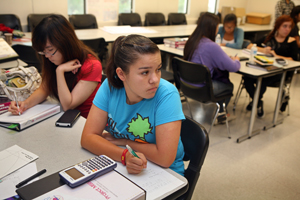 Nicole Arce looks up while working on a calculus problem.