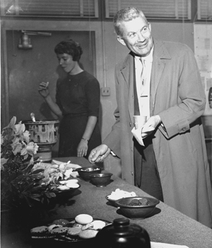 black and white photo of langsdorf in a buffet line.