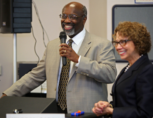 Interim CSUF President Willie Hagan joins Incoming President Mildred García at the podium during the Academic Senate meeting Jan. 26.