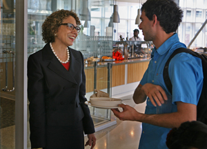 Incoming CSUF President Mildred García meets a student during lunch at the Gastronome.