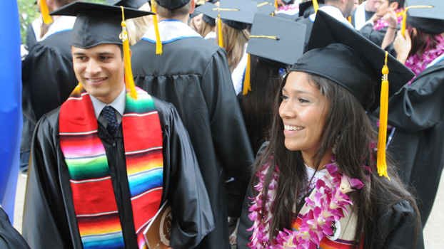 two Hispanic students in cap and gowns during the 2009 commencement ceremonies.