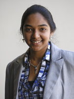 Indian woman wearing a gray suit with a blue blouse.