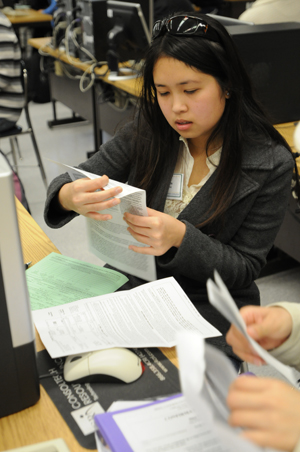 Linda Pham looks over a clients tax materials during the VITA program.