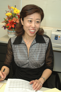 Asian woman smiling.