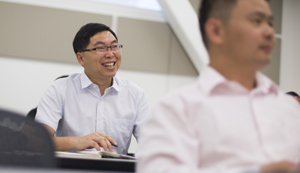 Dajin Yu smiles during discussion on teaching.