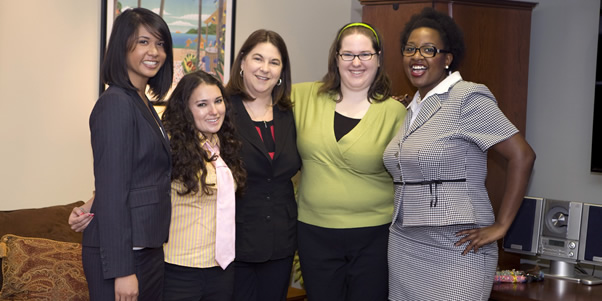 Stephanie Caragan with other interns from the T. Howard Foundation pose with NBC executive ViVi Zigler