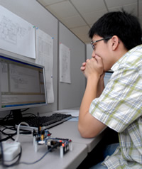 Ivan Check at a computer workstation