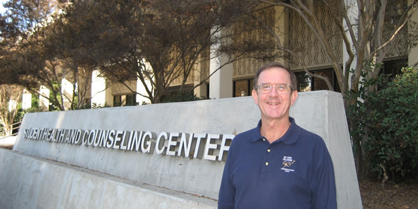 Richard Boucherr in front of the Student Health and Counseling Center