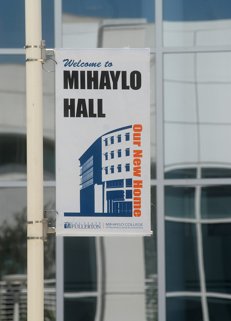 A banner welcoming students to Mihaylo Hall, home of Cal State Fullerton's business college