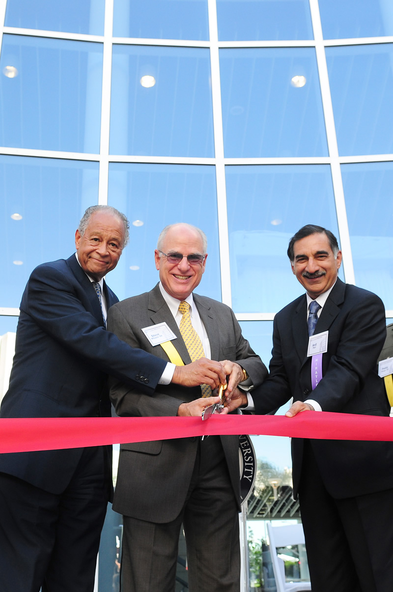 President Gordon, Steven G. Mihaylo, and Anil Puri cutting the ribbon at Mihaylo Hall's dedication ceremony