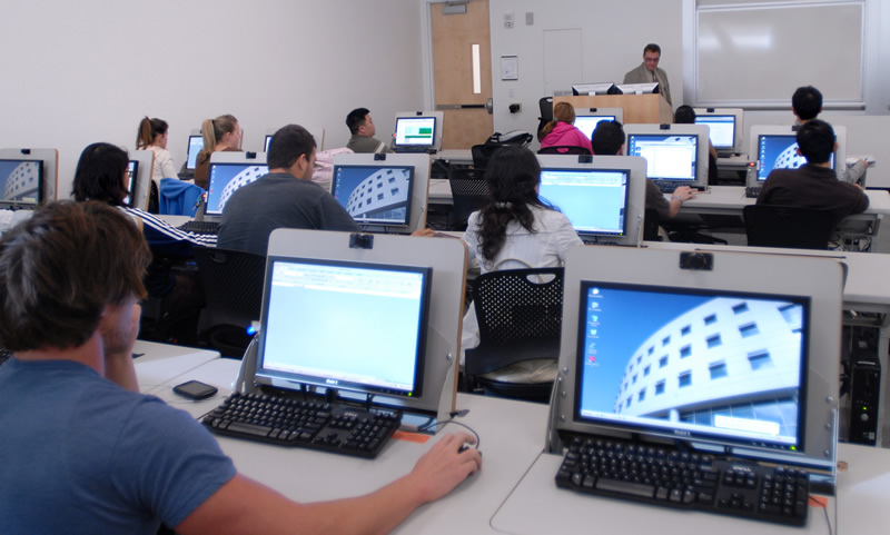 Students and their laptop computers in a classroom in Mihaylo Hall