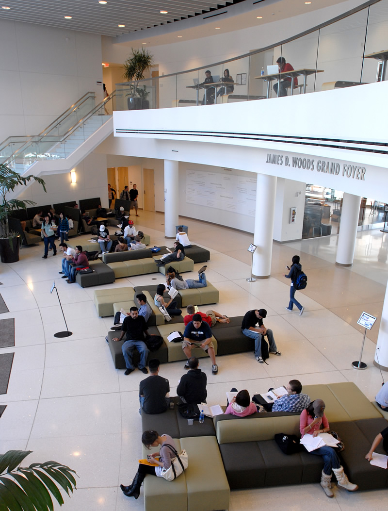 Students studying and relaxing in the James D. Woods Grand Foyer